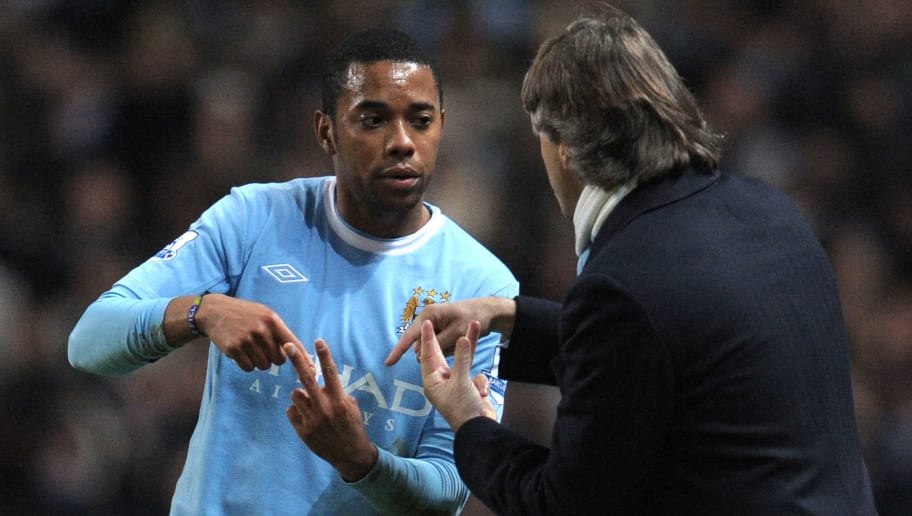 Manchester City's Brazilian forward Robinho (L) talks to Manchester City's Italian manager Roberto Mancini during the English Premier League football match against Blackburn Rovers at The City of Manchester stadium, Manchester, north-west England on January 11, 2010. AFP PHOTO/ANDREW YATES FOR  EDITORIAL USE Additional licence required for any commercial/promotional use or use on TV or internet (except identical online version of newspaper) of Premier League/Football League photos. Tel DataCo +44 207 2981656. Do not alter/modify photo (Photo credit should read ANDREW YATES/AFP/Getty Images)