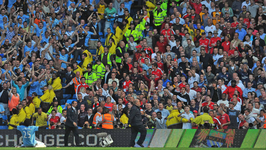 Manchester City's Togolese forward Emmanuel Adebayor (L) celebrates infront of the Arsenal fans after scoring during the English Premier League football match between Manchester City and Arsenal at The City of Manchester Stadium, Manchester, north-west England on September 12, 2009. AFP PHOTO/Andrew Yates - FOR EDITORIAL USE ONLY Additional licence required for any commercial/promotional use or use on TV or internet (except identical online version of newspaper) of Premier League/Football League photos. Tel DataCo +44 207 2981656. Do not alter/modify photo. (Photo credit should read ANDREW YATES/AFP/Getty Images)