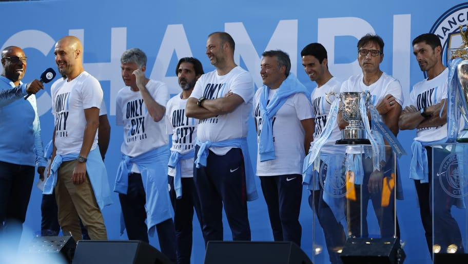 MANCHESTER, ENGLAND - MAY 14: Manchester City Manager Josep Guardiola and his coaching team on stage during the Manchester City Trophy Parade in Manchester city centre on May 14, 2018 in Manchester, England. (Photo by Lynne Cameron/Getty Images)