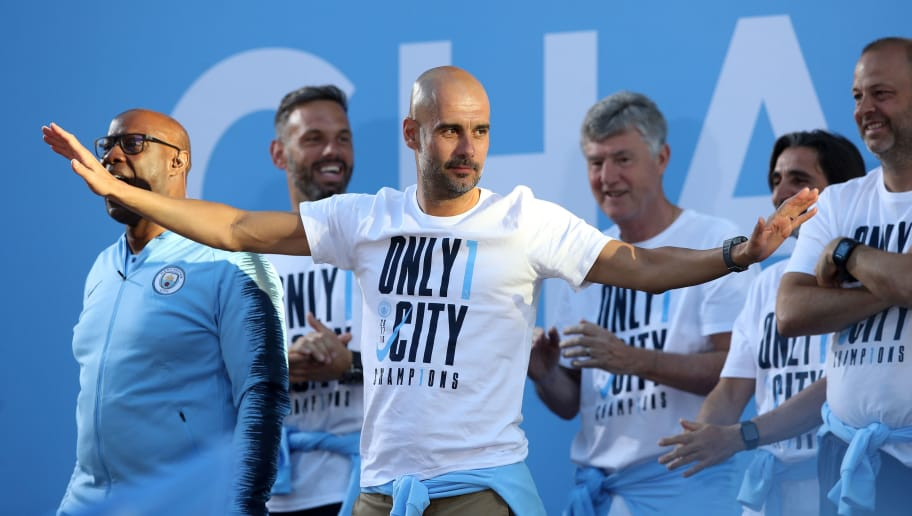 MANCHESTER, ENGLAND - MAY 14: Manchester City Manager Josep Guardiola on stage during the Manchester City Trophy Parade in Manchester city centre on May 14, 2018 in Manchester, England. (Photo by Lynne Cameron/Getty Images)