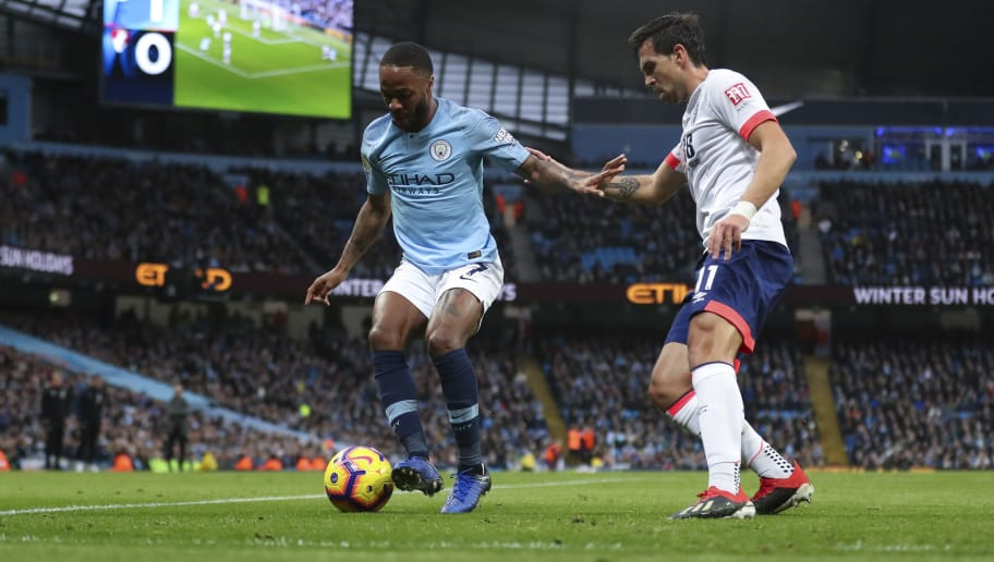 MANCHESTER, ENGLAND - DECEMBER 01: Raheem Sterling of Manchester City and Charlie Daniels of Bournemouth during the Premier League match between Manchester City and AFC Bournemouth at Etihad Stadium on December 1, 2018 in Manchester, United Kingdom. (Photo by James Baylis - AMA/Getty Images)