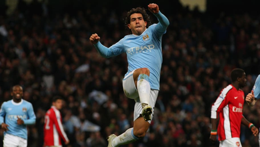 MANCHESTER, ENGLAND - DECEMBER 02:  Carlos Tevez of Man City (c) celebrates his goal during the Carling Cup quarter final match between Manchester City and Arsenal at City of Manchester stadium on December 2, 2009 in Manchester, England.  (Photo by Stu Forster/Getty Images)