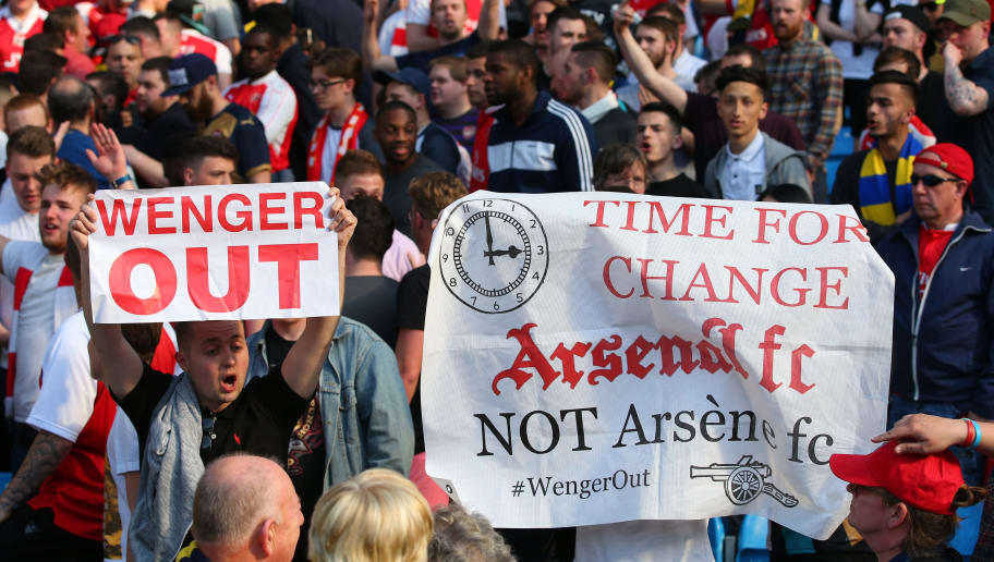 MANCHESTER, ENGLAND - MAY 08:  Arsenal fans display 'Wenger Out' banners following the Barclays Premier League match between Manchester City and Arsenal at the Etihad Stadium on May 8, 2016 in Manchester, England.  (Photo by Alex Livesey/Getty Images)