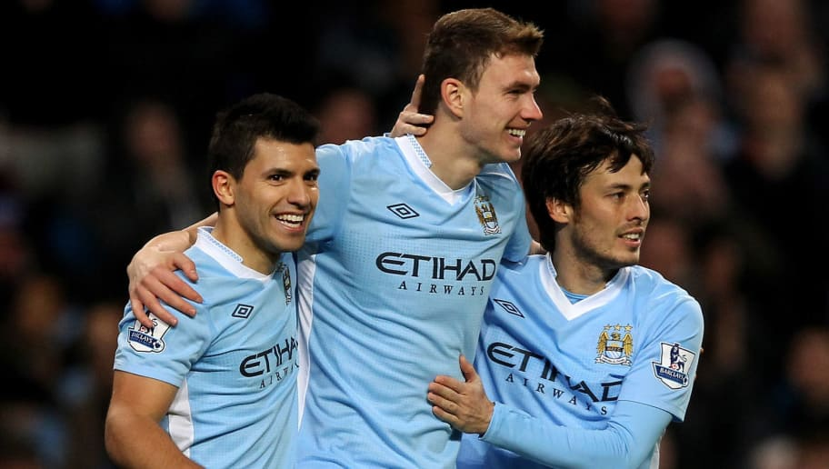 MANCHESTER, ENGLAND - FEBRUARY 25:  Edin Dzeko of Manchester City celebrates scoring his team's third goal with team mates Sergio Aguero (L) and David Silva (R) during the Barclays Premier League match between Manchester City and Blackburn Rovers at the Etihad Stadium on February 25, 2012 in Manchester, England.  (Photo by Alex Livesey/Getty Images)