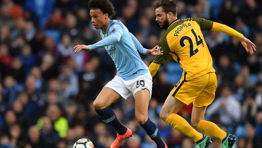 MANCHESTER, ENGLAND - MAY 09:  Leroy Sane of Manchester City gets past Davy Propper of Brighton & Hove Albion during the Premier League match between Manchester City and Brighton and Hove Albion at Etihad Stadium on May 9, 2018 in Manchester, England.  (Photo by Mike Hewitt/Getty Images)