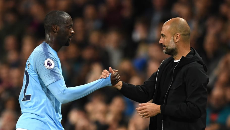 MANCHESTER, ENGLAND - MAY 09:  Yaya Toure of Manchester City shakes hands wtih Josep Guardiola, Manager of Manchester City after he is subbed off during the Premier League match between Manchester City and Brighton and Hove Albion at Etihad Stadium on May 9, 2018 in Manchester, England.  (Photo by Gareth Copley/Getty Images)