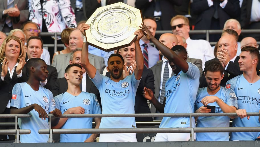 LONDON, ENGLAND - AUGUST 05:  Riyad Mahrez of Manchester City lifts the Community Shield Trophy following his side's victory during the FA Community Shield between Manchester City and Chelsea at Wembley Stadium on August 5, 2018 in London, England.  (Photo by Michael Regan/Getty Images)