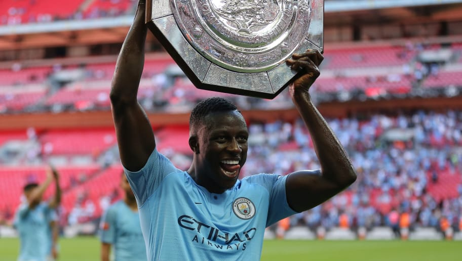 LONDON, ENGLAND - AUGUST 05: Benjamin Mendy of Manchester City celebrates with the FA Community Shield trophy after the FA Community Shield match between Manchester City and Chelsea at Wembley Stadium on August 5, 2018 in London, England. (Photo by James Baylis - AMA/Getty Images)