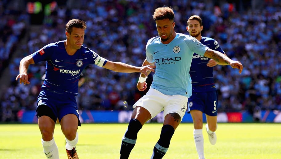 LONDON, ENGLAND - AUGUST 05: Kyle Walker of Manchester City (R) is challenged by Cesar Azpilicueta of Chelsea during the FA Community Shield match between Manchester City and Chelsea at Wembley Stadium on August 5, 2018 in London, England.  (Photo by Chris Brunskill/Fantasista/Getty Images)