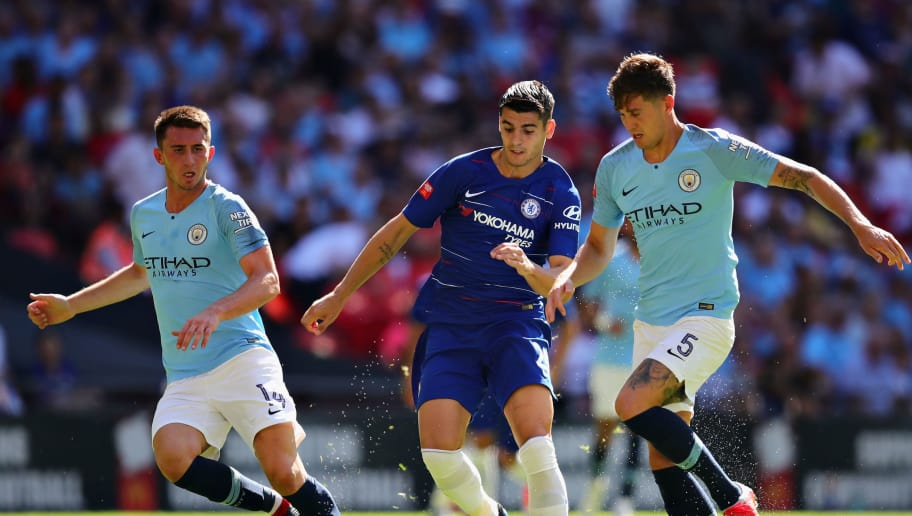 LONDON, ENGLAND - AUGUST 05: Alvaro Morata of Chelsea (centre) is challenged by Aymeric Laporte (L) and John Stones (L)  both of Manchester City during the FA Community Shield match between Manchester City and Chelsea at Wembley Stadium on August 5, 2018 in London, England.  (Photo by Chris Brunskill/Fantasista/Getty Images)
