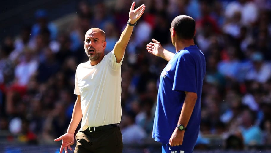 LONDON, ENGLAND - AUGUST 05: Manchester City manager Josep Guardiola (L) gestures towards Chelsea manager Maurizio Sarri during the FA Community Shield match between Manchester City and Chelsea at Wembley Stadium on August 5, 2018 in London, England.  (Photo by Chris Brunskill/Fantasista/Getty Images)