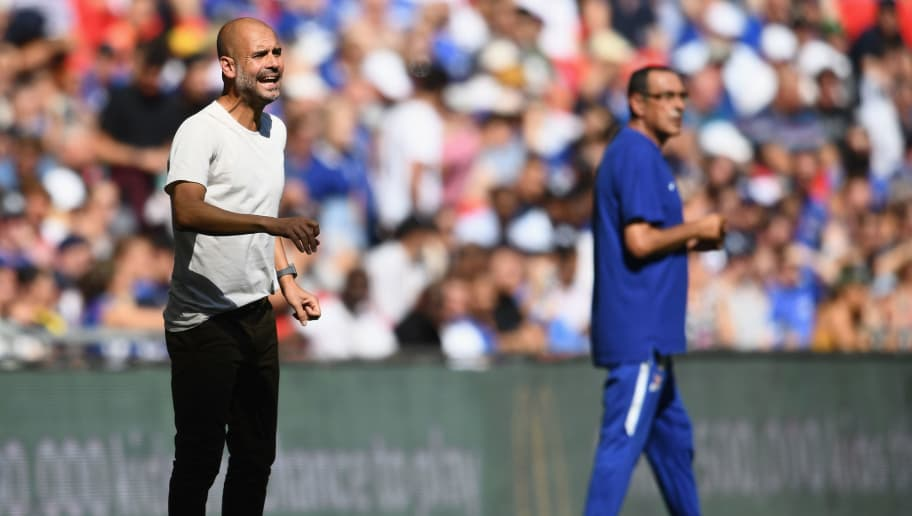 LONDON, ENGLAND - AUGUST 05:  Josep Guardiola, Manager of Manchester City reacts alongside Maurizio Sarri, Head Coach of Chelsea during the FA Community Shield between Manchester City and Chelsea at Wembley Stadium on August 5, 2018 in London, England.  (Photo by Clive Mason/Getty Images)