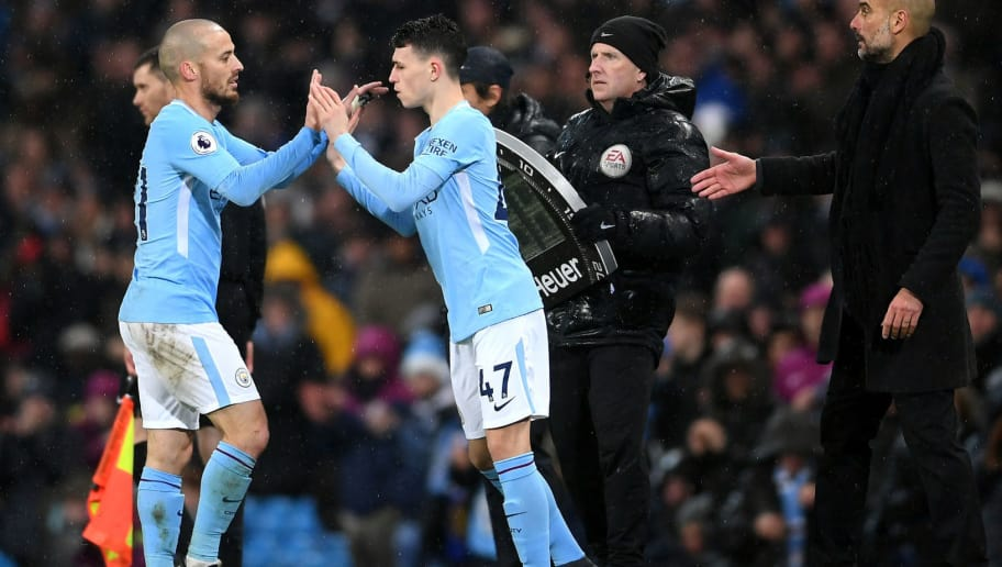 MANCHESTER, ENGLAND - MARCH 04:  David Silva of Manchester City is substituted for Phil Foden during the Premier League match between Manchester City and Chelsea at Etihad Stadium on March 4, 2018 in Manchester, England.  (Photo by Laurence Griffiths/Getty Images)