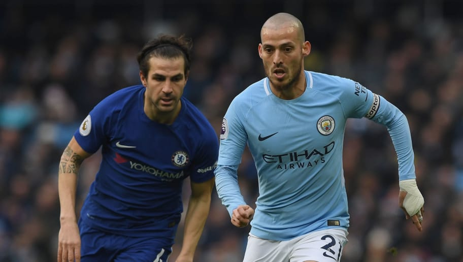 MANCHESTER, ENGLAND - MARCH 04:  David Silva of Manchester City breaks away from Cesc Fabregas of Chelsea during the Premier League match between Manchester City and Chelsea at Etihad Stadium on March 4, 2018 in Manchester, England.  (Photo by Shaun Botterill/Getty Images)