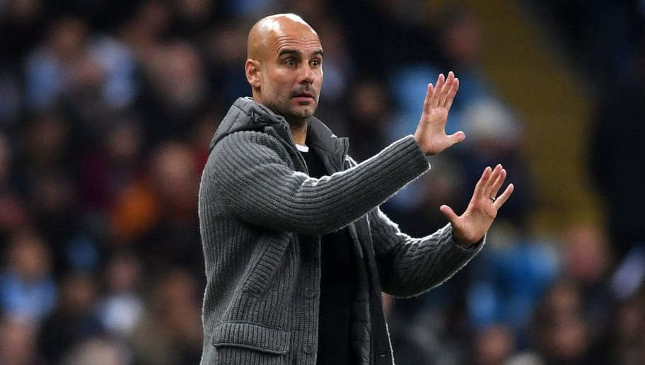 MANCHESTER, ENGLAND - NOVEMBER 07:  Josep Guardiola, Manager of Manchester City gives his team instructions during the Group F match of the UEFA Champions League between Manchester City and FC Shakhtar Donetsk at Etihad Stadium on November 7, 2018 in Manchester, United Kingdom.  (Photo by Laurence Griffiths/Getty Images)