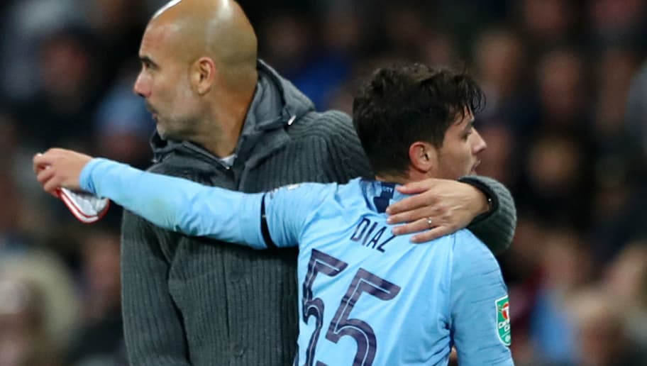 MANCHESTER, ENGLAND - NOVEMBER 01:  Brahim Diaz of Manchester City speaks with Josep Guardiola, Manager of Manchester City as he is substituted off during the Carabao Cup Fourth Round match between Manchester City and Fulham at Etihad Stadium on November 1, 2018 in Manchester, England.  (Photo by Matthew Lewis/Getty Images)