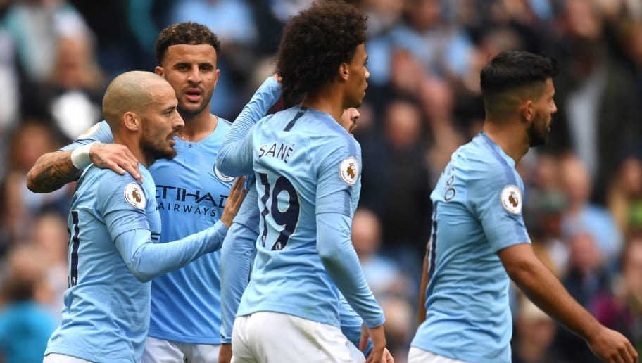MANCHESTER, ENGLAND - SEPTEMBER 15:  David Silva of Manchester City celebrates with teammates after scoring his team's second goal during the Premier League match between Manchester City and Fulham FC at Etihad Stadium on September 15, 2018 in Manchester, United Kingdom.  (Photo by Michael Regan/Getty Images)