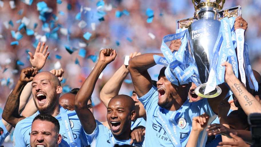 MANCHESTER, ENGLAND - MAY 06: Vincent Kompany of Manchester City lifts the Premier League Trophy alongside David Silva, Nicolas Otamendi and Fernandinho as Manchester City celebrate winning the Premier League Title during the Premier League match between Manchester City and Huddersfield Town at Etihad Stadium on May 6, 2018 in Manchester, England.  (Photo by Laurence Griffiths/Getty Images)