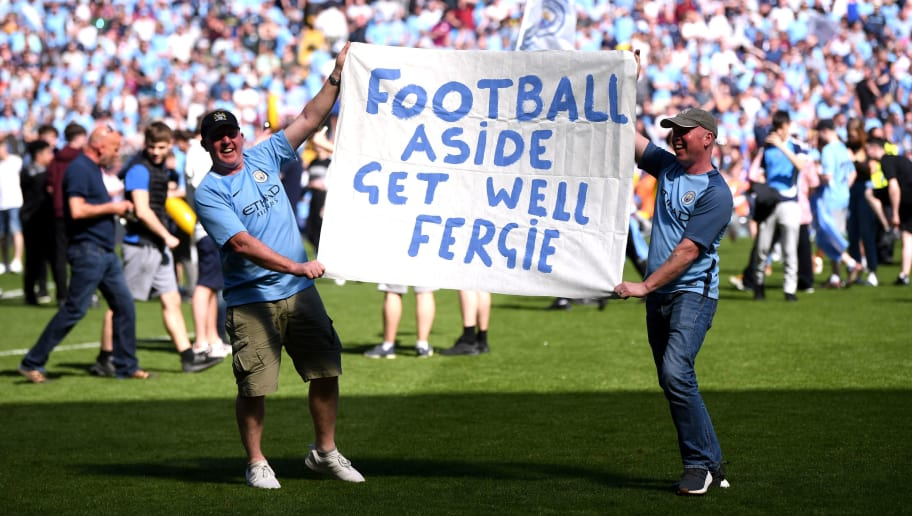 MANCHESTER, ENGLAND - MAY 06:  Two Manchester City fans hold up a banner for Alex Fergurson after the Premier League match between Manchester City and Huddersfield Town at Etihad Stadium on May 6, 2018 in Manchester, England.  (Photo by Laurence Griffiths/Getty Images)