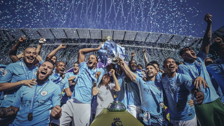 MANCHESTER, ENGLAND - MAY 06: [Editor's note - digital filters were used in the creation of this image] Vincent Kompany and Sergio Aguero of Manchester City lift the Premier League trophy during the Premier League match between Manchester City and Huddersfield Town at Etihad Stadium on May 6, 2018 in Manchester, England.  (Photo by Michael Regan/Getty Images)