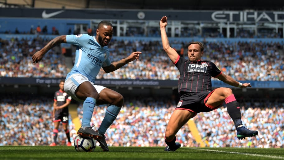 MANCHESTER, ENGLAND - MAY 06:  Raheem Sterling of Manchester City controls the ball as Alex Pritchard of Huddersfield Town looks on during the Premier League match between Manchester City and Huddersfield Town at Etihad Stadium on May 6, 2018 in Manchester, England.  (Photo by Michael Regan/Getty Images)