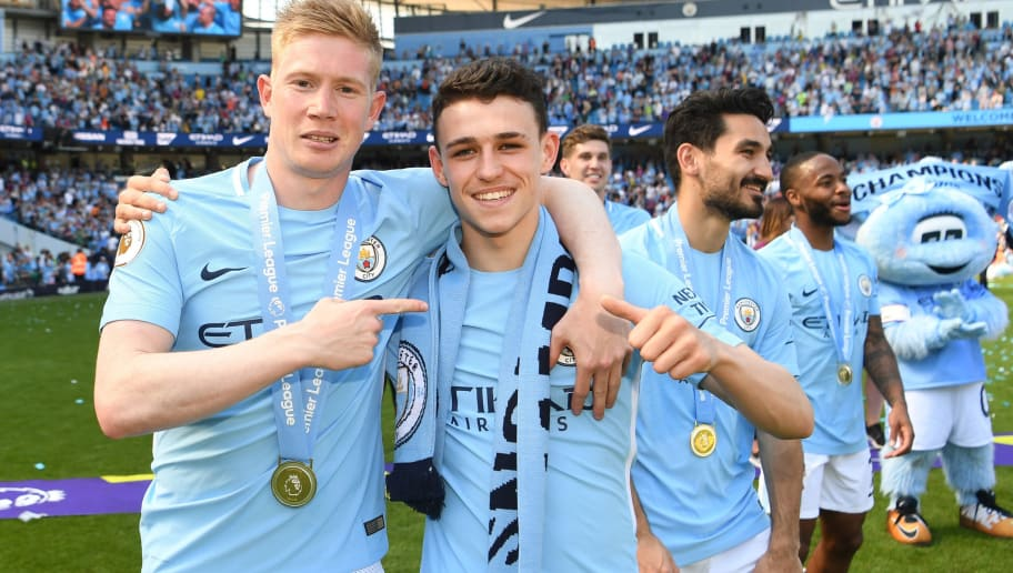MANCHESTER, ENGLAND - MAY 06: Kevin De Bruyne of Manchester City and Phil Foden of Manchester City celebrate winning the premier league after the Premier League match between Manchester City and Huddersfield Town at Etihad Stadium on May 6, 2018 in Manchester, England.  (Photo by Michael Regan/Getty Images)