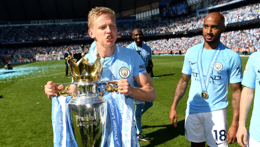 MANCHESTER, ENGLAND - MAY 06: Alexander Zinchenko of Manchester City celebrate with The Premier League Trophy after the Premier League match between Manchester City and Huddersfield Town at Etihad Stadium on May 6, 2018 in Manchester, England.  (Photo by Michael Regan/Getty Images)
