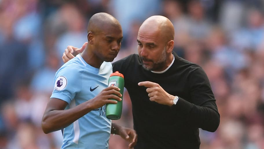 MANCHESTER, ENGLAND - MAY 06:  Fernandinho of Manchester City is given instruction by Josep Guardiola, Manager of Manchester City  during the Premier League match between Manchester City and Huddersfield Town at Etihad Stadium on May 6, 2018 in Manchester, England.  (Photo by Laurence Griffiths/Getty Images)