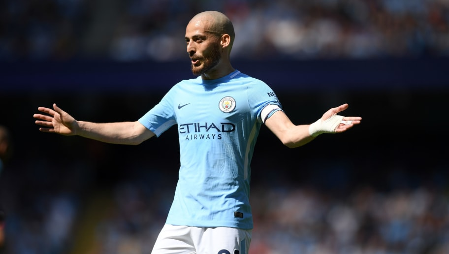 MANCHESTER, ENGLAND - MAY 06:  David Silva of Manchester City reacts during the Premier League match between Manchester City and Huddersfield Town at Etihad Stadium on May 6, 2018 in Manchester, England.  (Photo by Shaun Botterill/Getty Images)