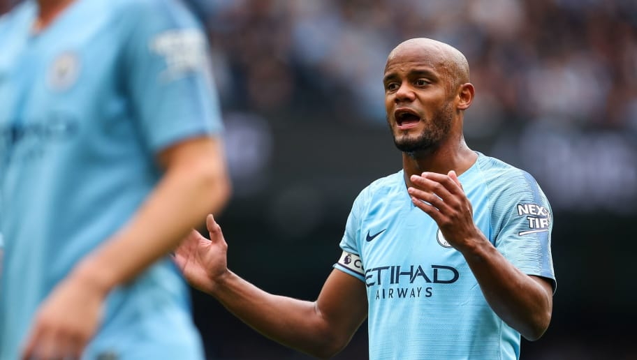 MANCHESTER, ENGLAND - AUGUST 19: Vincent Kompany  of Manchester City during the Premier League match between Manchester City and Huddersfield Town at Etihad Stadium on August 19, 2018 in Manchester, United Kingdom. (Photo by Robbie Jay Barratt - AMA/Getty Images)