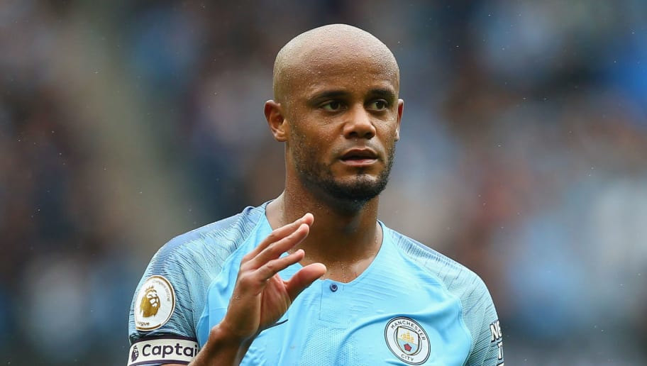 MANCHESTER, ENGLAND - AUGUST 19:  Vincent Kompany of Manchester City looks on during the Premier League match between Manchester City and Huddersfield Town at Etihad Stadium on August 19, 2018 in Manchester, United Kingdom.  (Photo by Alex Livesey/Getty Images)