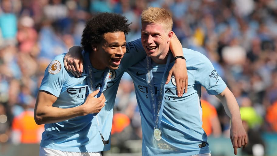 MANCHESTER, ENGLAND - MAY 06: Leroy Sane and Kevin De Bruyne of Manchester City during the championship celebrations after the Premier League match between Manchester City and Huddersfield Town at Etihad Stadium on May 6, 2018 in Manchester, England. (Photo by Matthew Ashton - AMA/Getty Images)