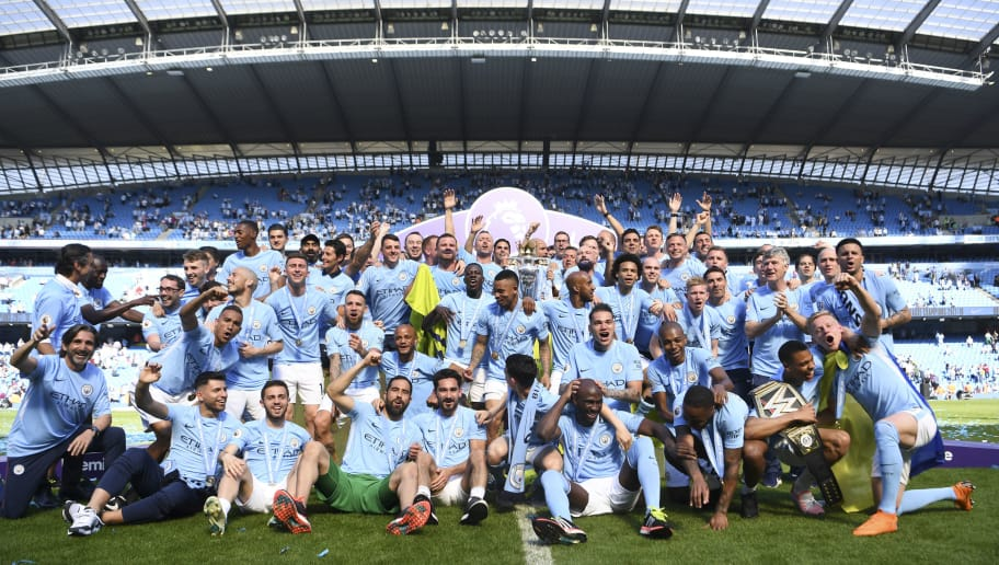 MANCHESTER, ENGLAND - MAY 06: The Manchester City squad celebrate with the Premier League trophy during the Premier League match between Manchester City and Huddersfield Town at Etihad Stadium on May 6, 2018 in Manchester, England.  (Photo by Michael Regan/Getty Images)