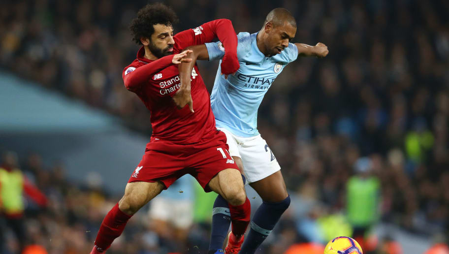 MANCHESTER, ENGLAND - JANUARY 03: Mohamed Salah of Liverpool battles for possession with Fernandinho of Manchester City during the Premier League match between Manchester City and Liverpool FC at the Etihad Stadium on January 3, 2019 in Manchester, United Kingdom.  (Photo by Clive Brunskill/Getty Images)