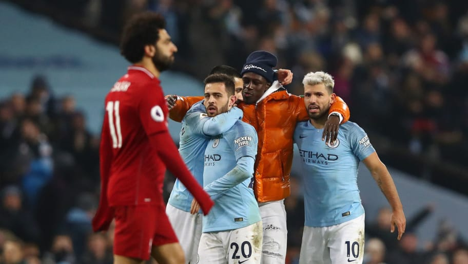 MANCHESTER, ENGLAND - JANUARY 03: Benjamin Mendy of Manchester City celebrates victory with Sergio Aguero, Bernardo Silva and Ilkay Gundogan of Manchester City as Mohamed Salah of Liverpool reacts after the Premier League match between Manchester City and Liverpool FC at the Etihad Stadium on January 3, 2019 in Manchester, United Kingdom.  (Photo by Clive Brunskill/Getty Images)