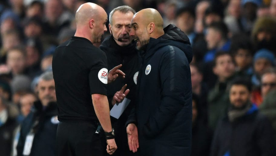 MANCHESTER, ENGLAND - JANUARY 03:  Referee Anthony Taylor speaks to Josep Guardiola, Manager of Manchester City during the Premier League match between Manchester City and Liverpool FC at the Etihad Stadium on January 3, 2019 in Manchester, United Kingdom.  (Photo by Shaun Botterill/Getty Images)