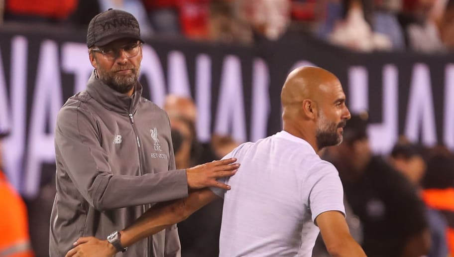 EAST RUTHERFORD, NJ - JULY 25: Jurgen Klopp manager / head coach of Liverpool and Pep Guardiola the head coach / manager of Manchester City during the International Champions Cup 2018 match between Manchester City and Liverpool at MetLife Stadium on July 25, 2018 in East Rutherford, New Jersey. (Photo by Robbie Jay Barratt - AMA/Getty Images)