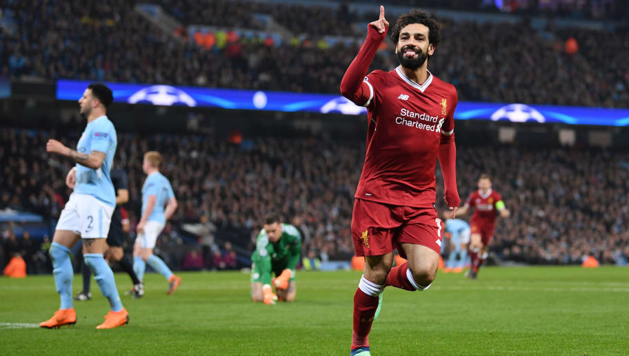 MANCHESTER, ENGLAND - APRIL 10:  Mohamed Salah of Liverpool celebrates scoring the first goal during the Quarter Final Second Leg match between Manchester City and Liverpool at Etihad Stadium on April 10, 2018 in Manchester, England.  (Photo by Laurence Griffiths/Getty Images,)