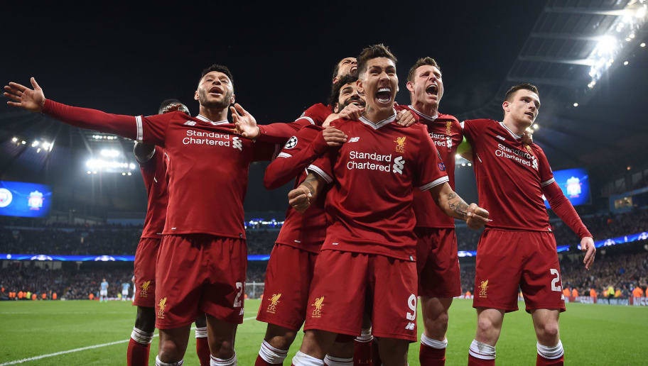 MANCHESTER, ENGLAND - APRIL 10:  Roberto Firmino of Liverpool celebrates scoring the second goal with Alex Oxlade-Chamberlain, Virgil Van Dijk, James Milner and Andy Roberton during the Quarter Final Second Leg match between Manchester City and Liverpool at Etihad Stadium on April 10, 2018 in Manchester, England.  (Photo by Laurence Griffiths/Getty Images,)