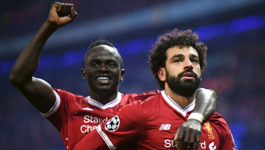 MANCHESTER, ENGLAND - APRIL 10:  Mohamed Salah of Liverpool celebrates with teammate Sadio Mane after scoring his sides first goal during the UEFA Champions League Quarter Final Second Leg match between Manchester City and Liverpool at Etihad Stadium on April 10, 2018 in Manchester, England.  (Photo by Laurence Griffiths/Getty Images,)