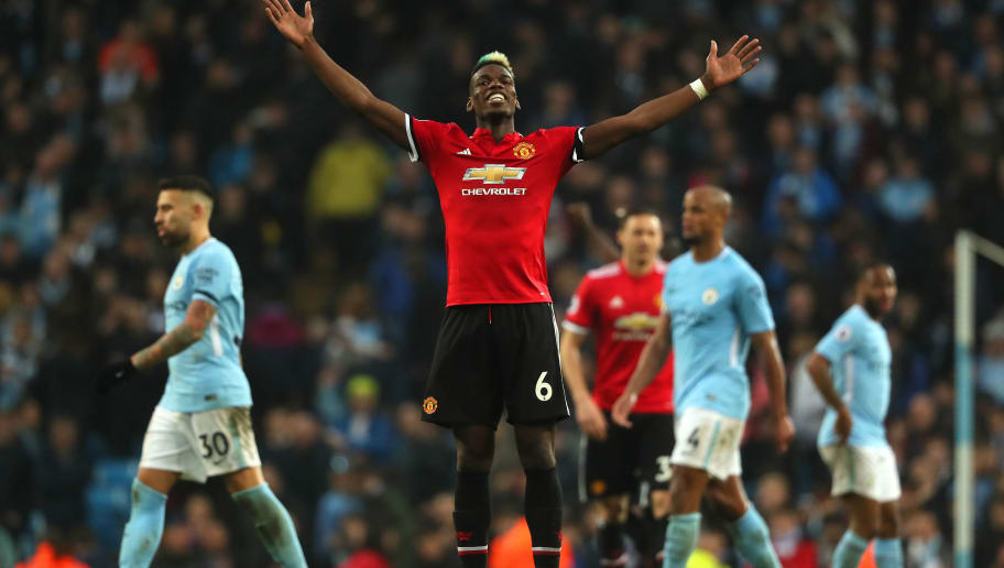 MANCHESTER, ENGLAND - APRIL 07:  Paul Pogba of Manchester United celebrates at the end of the Premier League match between Manchester City and Manchester United at Etihad Stadium on April 7, 2018 in Manchester, England. (Photo by Matthew Ashton - AMA/Getty Images)