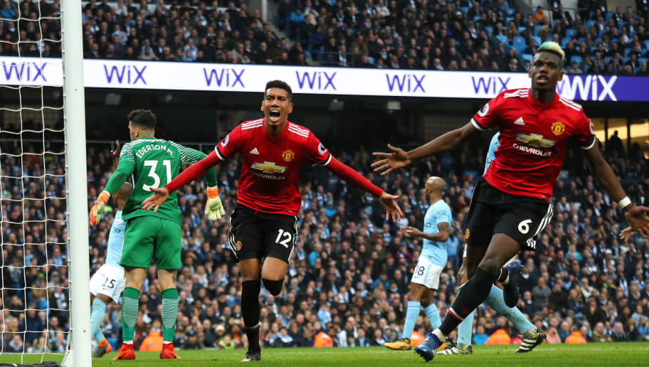 MANCHESTER, ENGLAND - APRIL 07:  Chris Smalling of Manchester United celebrates scoring a goal to make the score 2-3 during the Premier League match between Manchester City and Manchester United at Etihad Stadium on April 7, 2018 in Manchester, England. (Photo by Matthew Ashton - AMA/Getty Images)