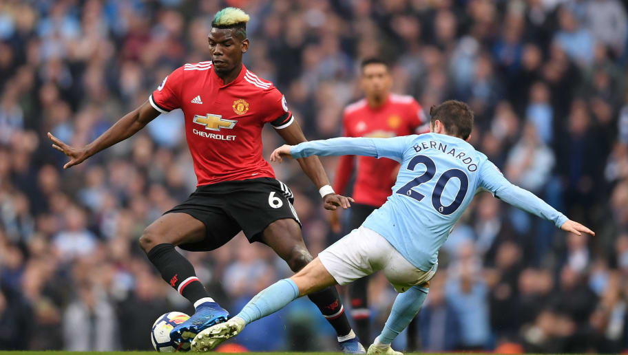 MANCHESTER, ENGLAND - APRIL 07:  Paul Pogba of Manchester United is challenged by Bernardo Silva of Manchester City during the Premier League match between Manchester City and Manchester United at Etihad Stadium on April 7, 2018 in Manchester, England.  (Photo by Laurence Griffiths/Getty Images)