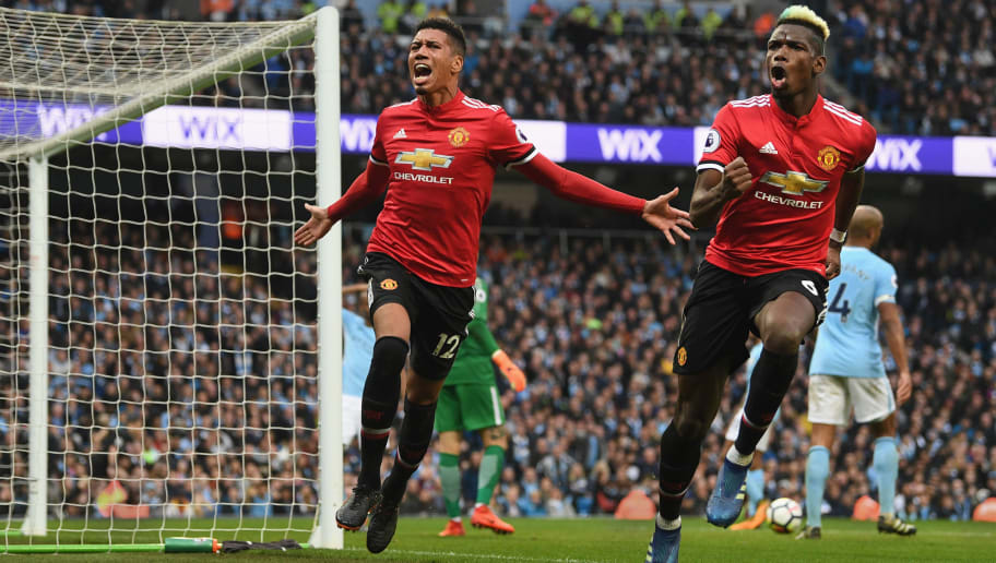 MANCHESTER, ENGLAND - APRIL 07: Chris Smalling of Manchester United celebrates scoring his side's third goal with Paul Pogba during the Premier League match between Manchester City and Manchester United at Etihad Stadium on April 7, 2018 in Manchester, England. (Photo by Michael Regan/Getty Images)