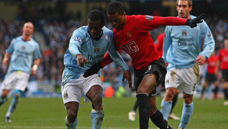 MANCHESTER, UNITED KINGDOM - NOVEMBER 30:  Shaun Wright-Phillips of Manchester City battles for the ball with Patrice Evra of Manchester United during the Barclays Premier League match between Manchester City and Manchester United at The City of Manchester Stadium on November 30, 2008 in Manchester, England.  (Photo by Jamie McDonald/Getty Images)