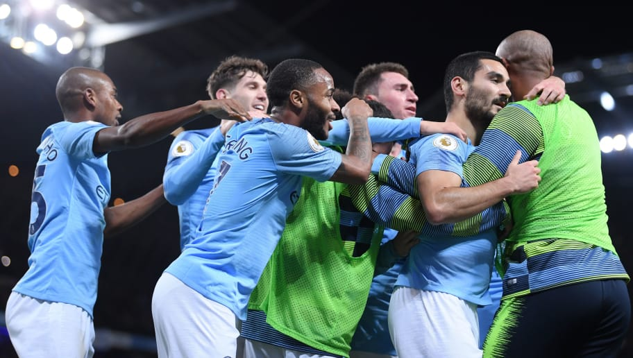 MANCHESTER, ENGLAND - NOVEMBER 11:  Ilkay Gundogan of Manchester City (2R) celebrates with teammates after scoring his team's third goal during the Premier League match between Manchester City and Manchester United at Etihad Stadium on November 11, 2018 in Manchester, United Kingdom.  (Photo by Laurence Griffiths/Getty Images)