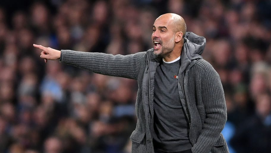 MANCHESTER, ENGLAND - NOVEMBER 11:  Josep Guardiola, Manager of Manchester City gives his team instructions during the Premier League match between Manchester City and Manchester United at Etihad Stadium on November 11, 2018 in Manchester, United Kingdom.  (Photo by Laurence Griffiths/Getty Images)
