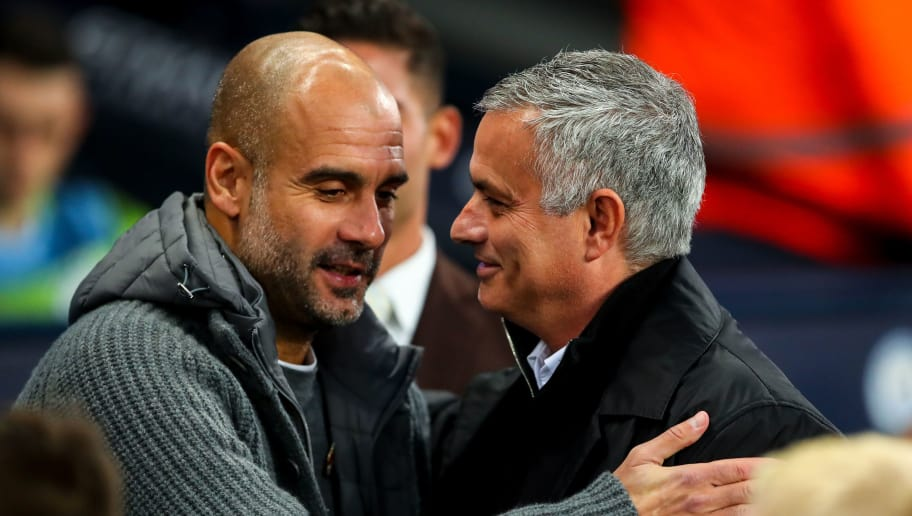 MANCHESTER, ENGLAND - NOVEMBER 11: Pep Guardiola the head coach / manager of Manchester City  and Jose Mourinho the head coach / manager of Manchester United during the Premier League match between Manchester City and Manchester United at Etihad Stadium on November 11, 2018 in Manchester, United Kingdom. (Photo by Robbie Jay Barratt - AMA/Getty Images)