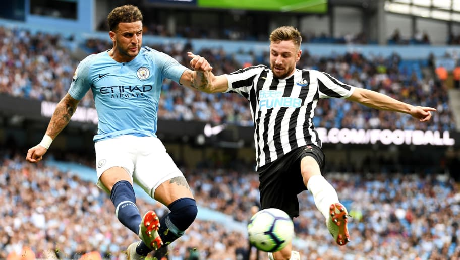 MANCHESTER, ENGLAND - SEPTEMBER 01: Kyle Walker of Manchester City is challenged by Paul Dummett of Newcastle United during the Premier League match between Manchester City and Newcastle United at Etihad Stadium on September 1, 2018 in Manchester, United Kingdom.  (Photo by Clive Mason/Getty Images)