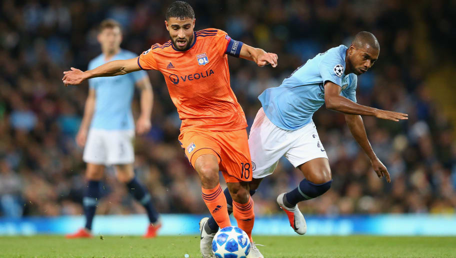 MANCHESTER, ENGLAND - SEPTEMBER 19:  Nabil Fekir of Olympique Lyonnais tackles Fernandinho of Manchester City during the Group F match of the UEFA Champions League between Manchester City and Olympique Lyonnais at Etihad Stadium on September 19, 2018 in Manchester, United Kingdom.  (Photo by Alex Livesey - Danehouse/Getty Images)